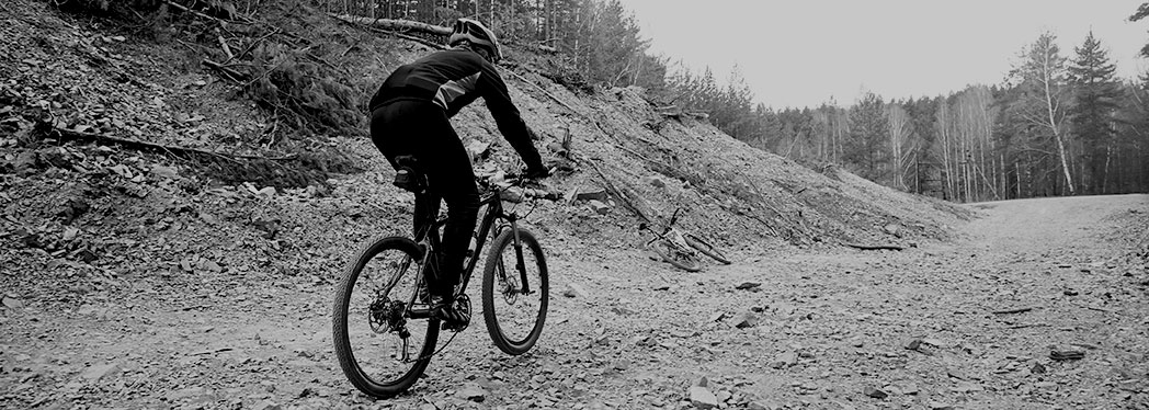 mountain-biker-on-trail-black-and-white