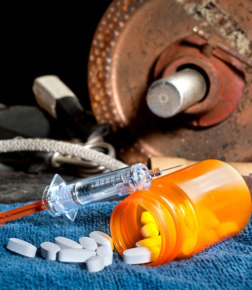 performance_enhancing_drugs_weights_needles_pills